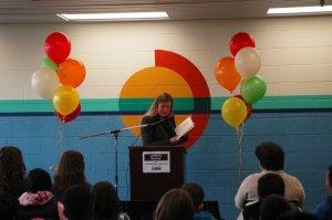 Susan Wilson, Principal of St. Angela Merici reading a poem.